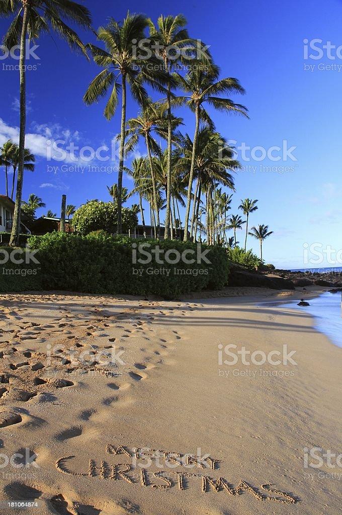 Merry Christmas written on Maui Hawaii resort hotel beach sand royalty-free stock photo