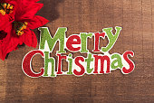 merry Christmas written on wooden background
