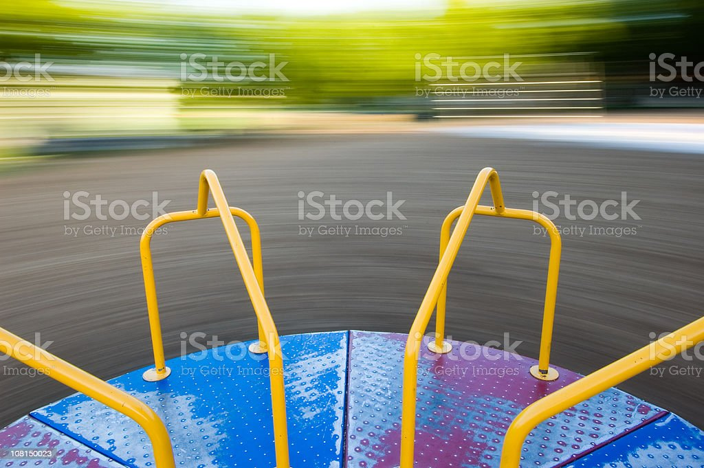 Merry Go-Round Spinning, Motion Blur of Background stock photo