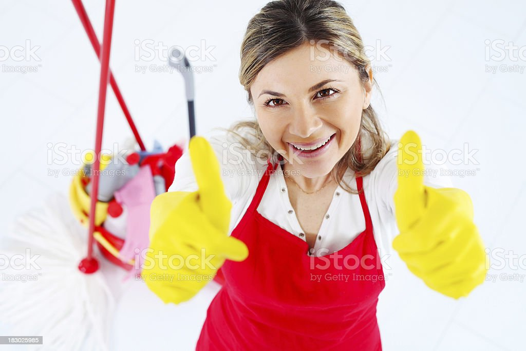 Merry maid raised hands in the sign ok royalty-free stock photo