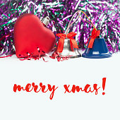Merry xmas card with red heart, jingle bells and ribbons