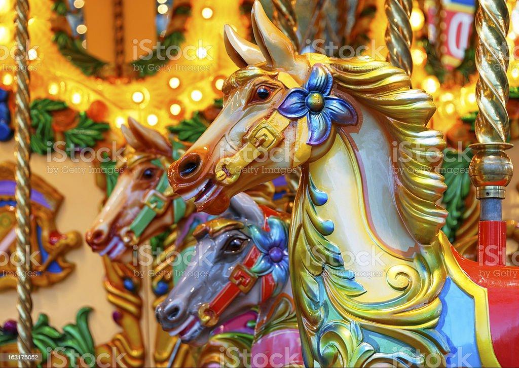 Merry-go-round horses stock photo