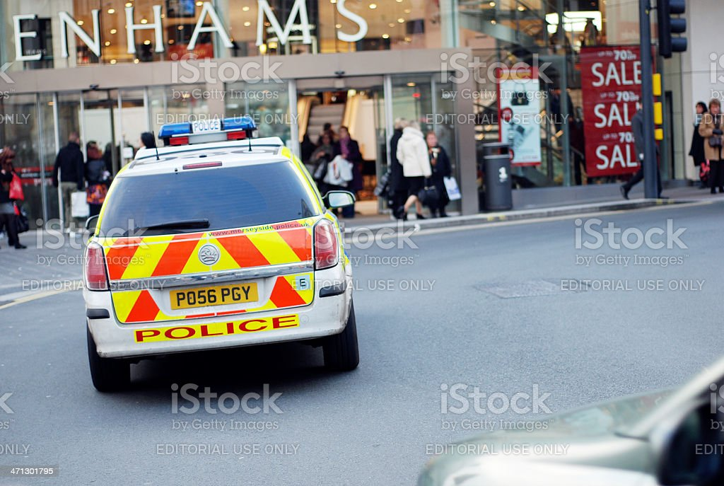 Merseyside Police car in front of Debenhams store royalty-free stock photo