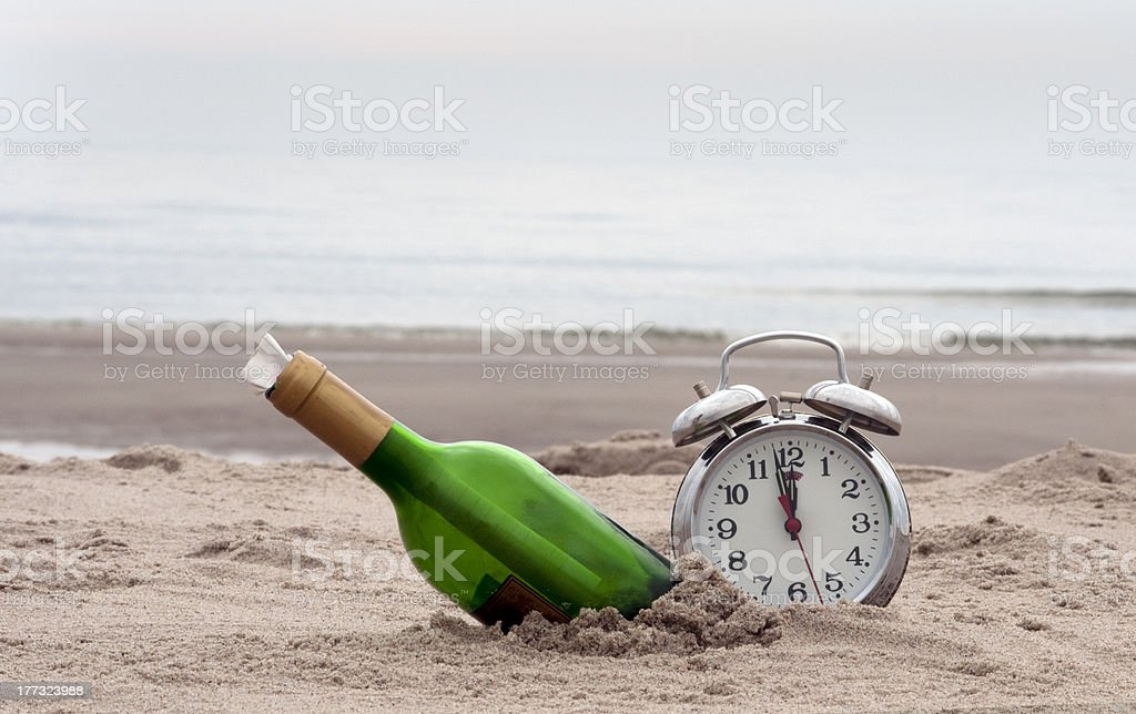 mesaage in a bottle woith the clock royalty-free stock photo