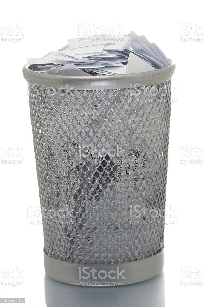 Mesh trash bin full of paper royalty-free stock photo