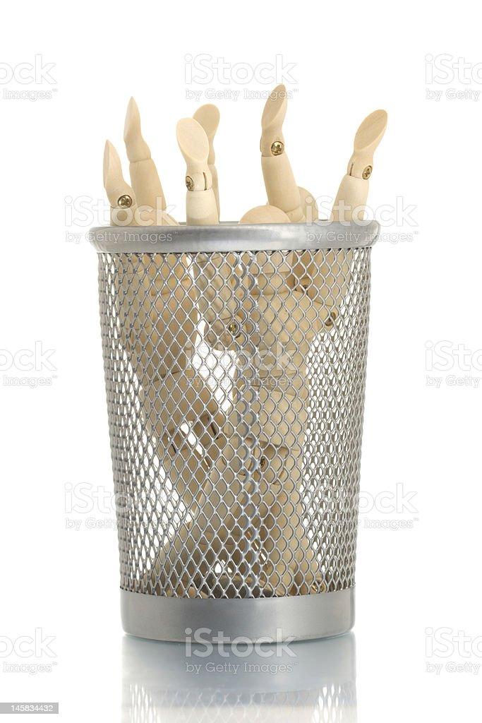 Mesh trash bin with many manikins inside royalty-free stock photo