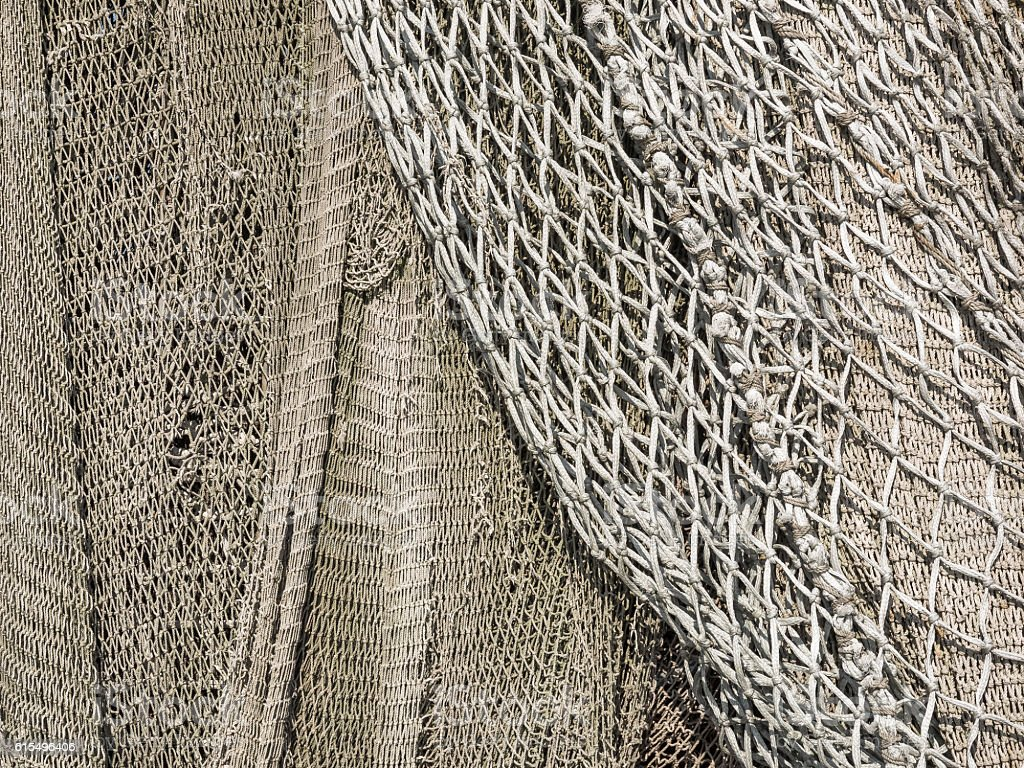 Meshes of a fishing net to use as background stock photo
