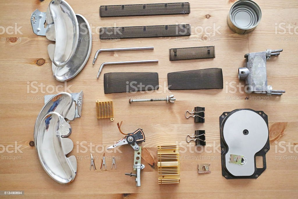 Mess of metal parts on top of table stock photo