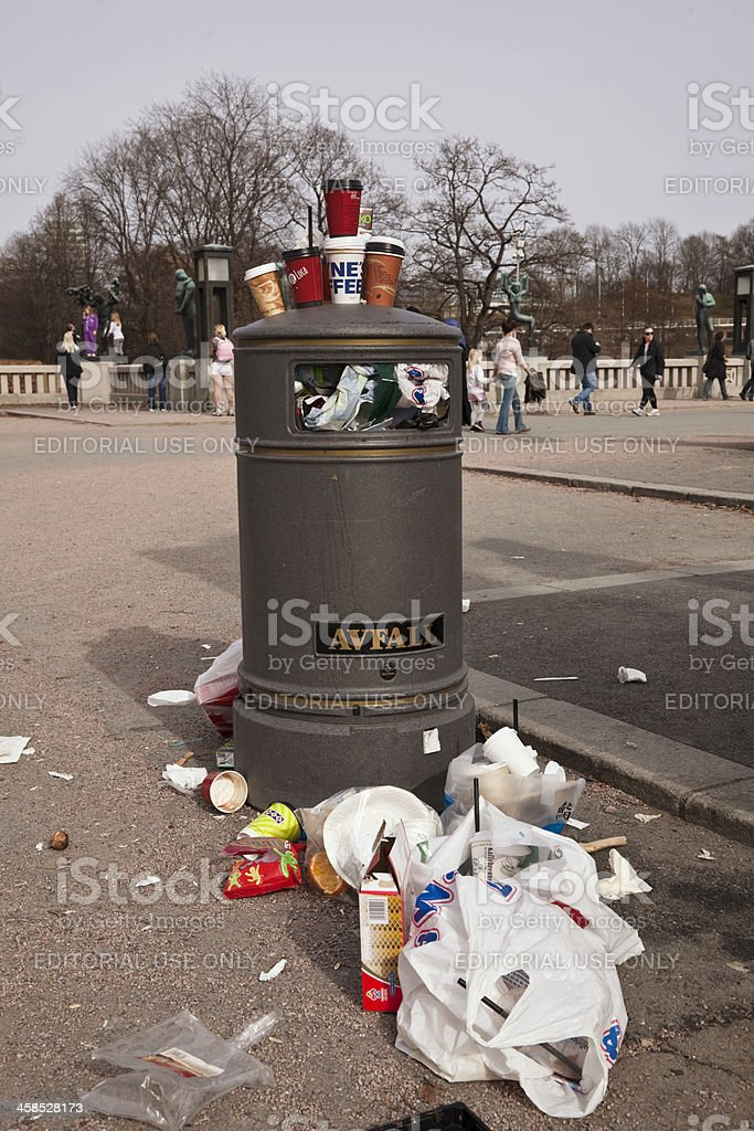 Mess of used take-away paper  coffe cups by litter box. royalty-free stock photo