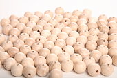 Mess of wooden beads, speheres on white background