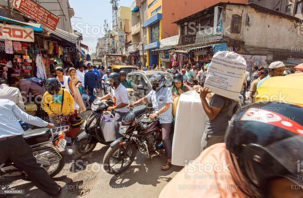 Mess on crossroad with crowd of busy people, motorbikes making traffic jam stock photo