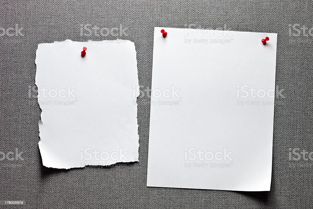 Message board with empty sheet of ripped paper stock photo