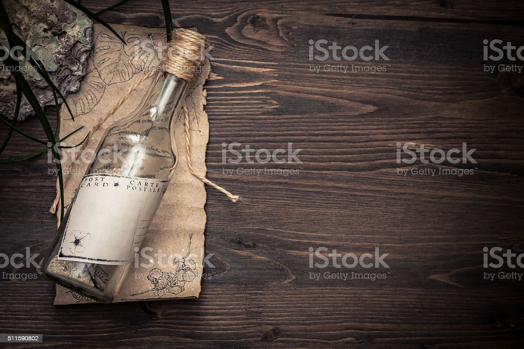 Message in a bottle on old paper with copy space stock photo