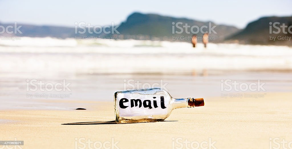 """Message in bottle saying """"email"""" is ignored on beach royalty-free stock photo"""