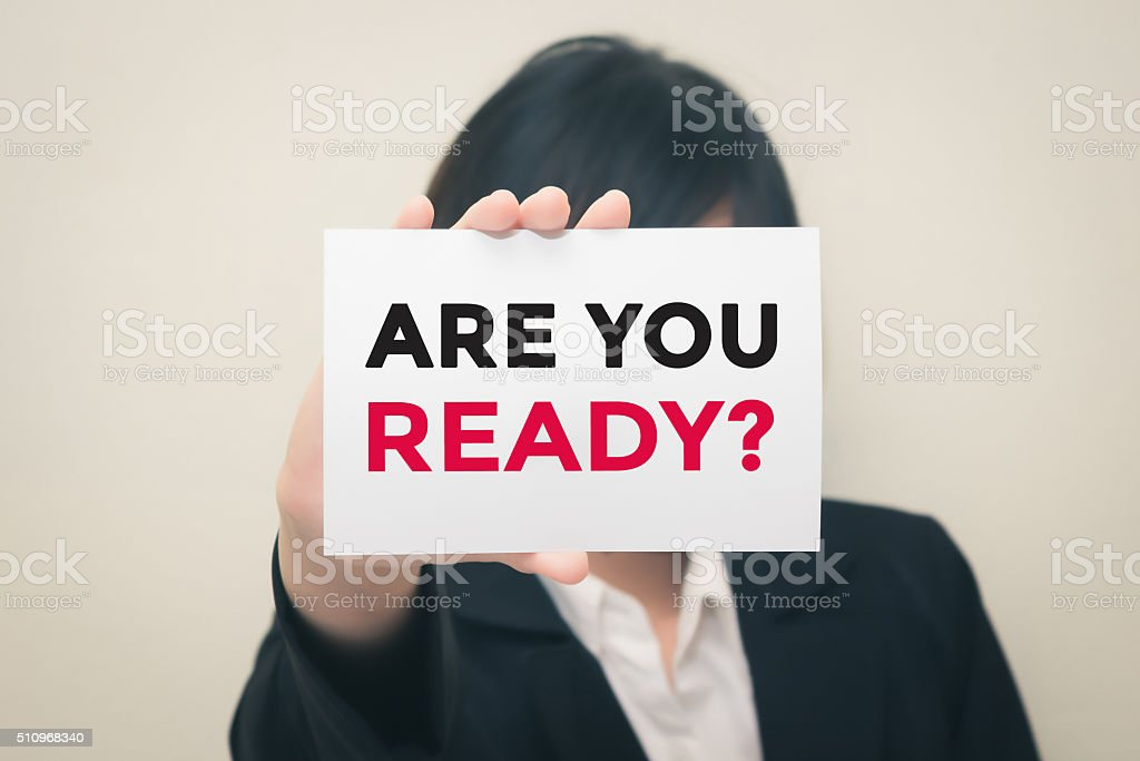 ARE YOU READY, message on the card Held by women. stock photo