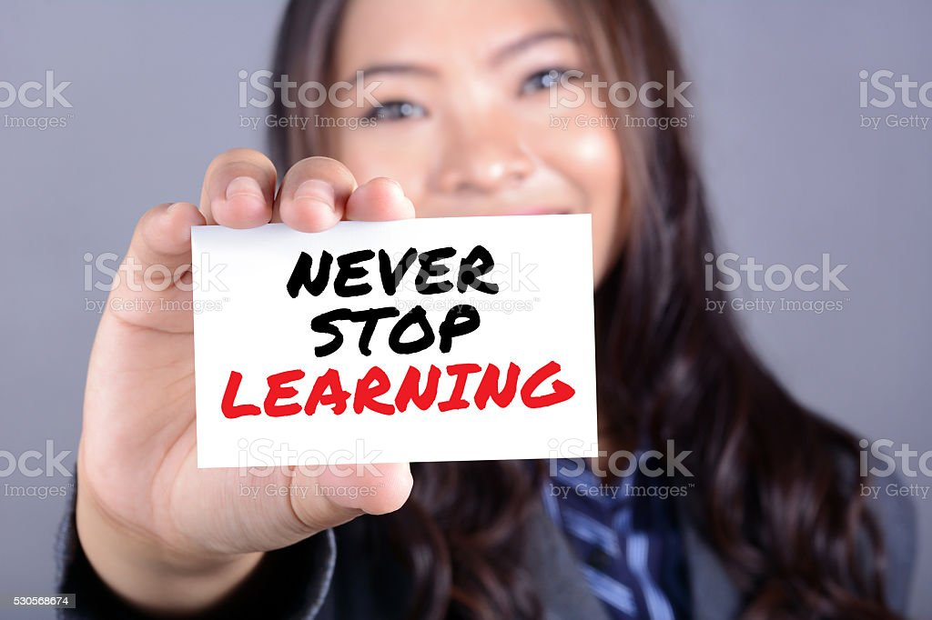 NEVER STOP LEARNING, message on the card stock photo