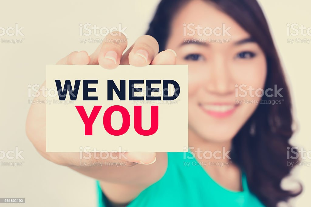 WE NEED YOU, message on the card stock photo
