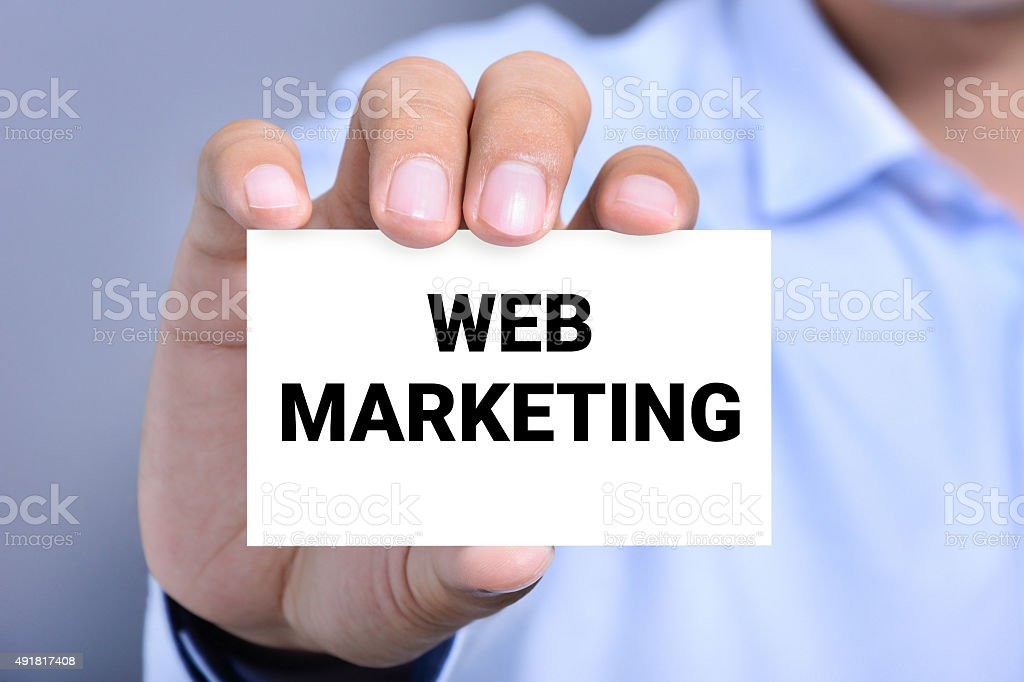 WEB MARKETING message on the card shown by a man stock photo