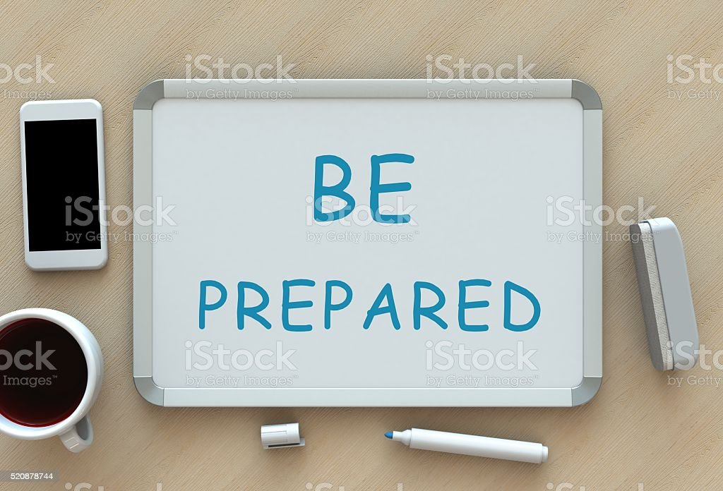 BE PREPARED, message on whiteboard, smart phone and coffee stock photo