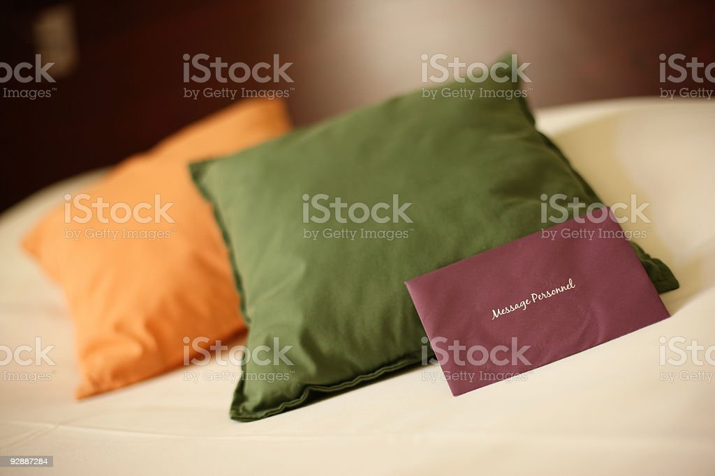 Message Personnel on hotel pillow stock photo