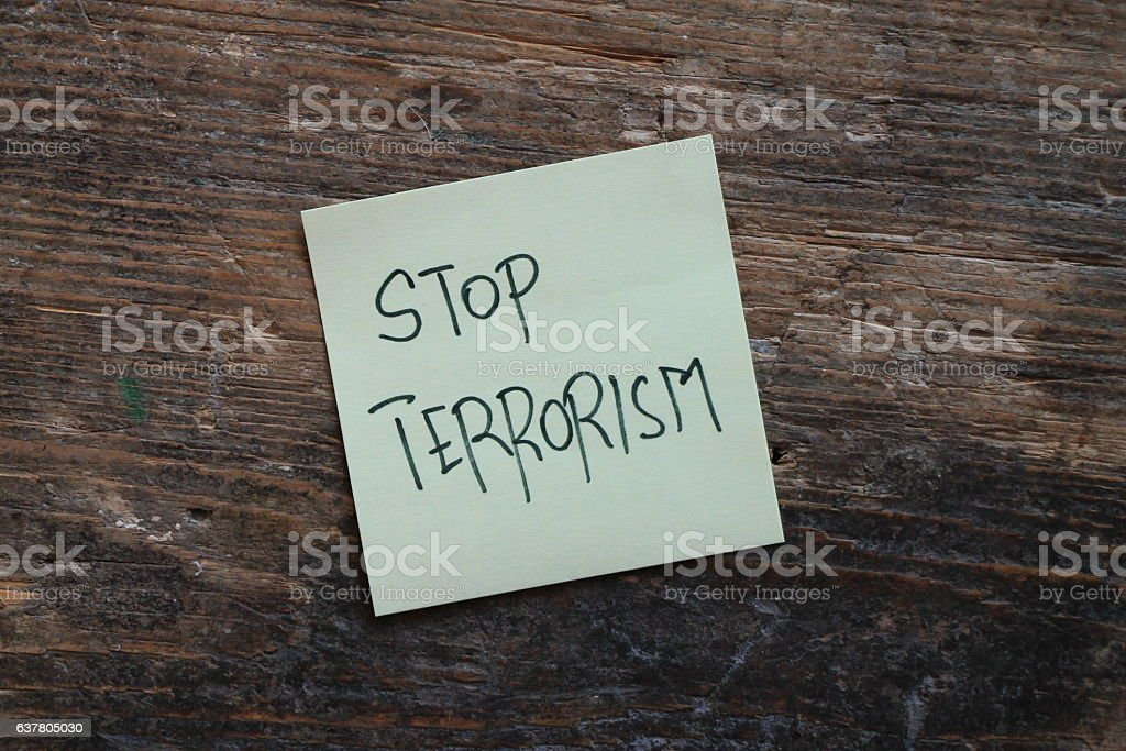 Message Stop terrorism on wooden table stock photo