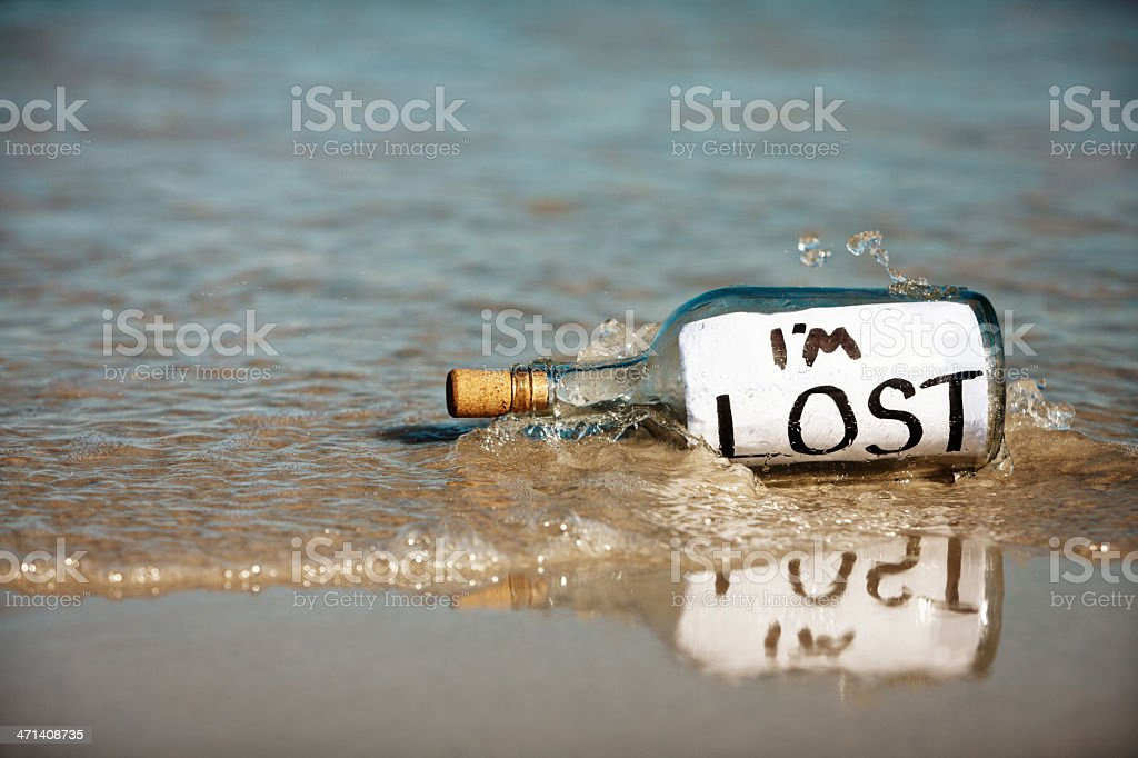 Message washed up on beach from castaway: I'm lost stock photo