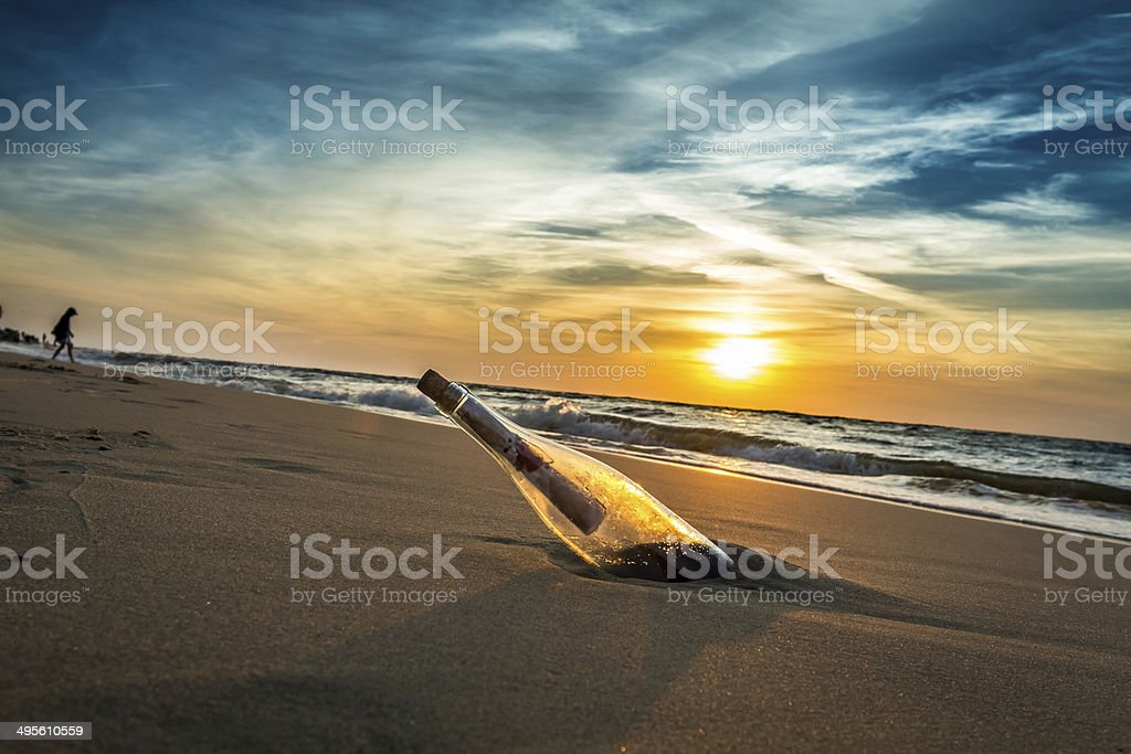 Message with letter inside the bottle stock photo
