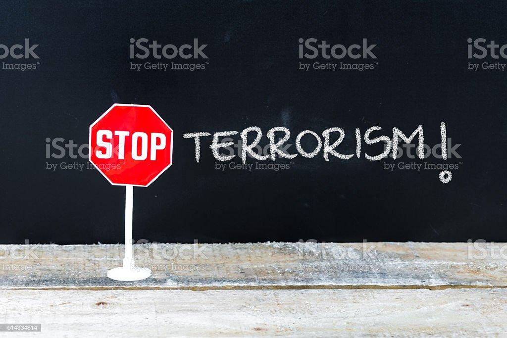 STOP TERRORISM message written on chalkboard stock photo