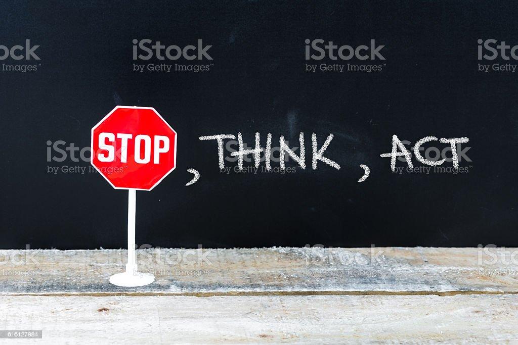 STOP, THINK, ACT message written on chalkboard stock photo