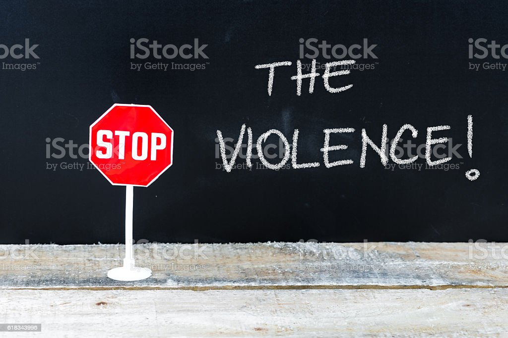 STOP THE VIOLENCE message written on chalkboard stock photo