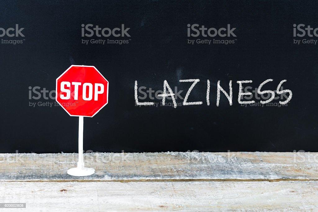 STOP LAZINESS message written on chalkboard stock photo