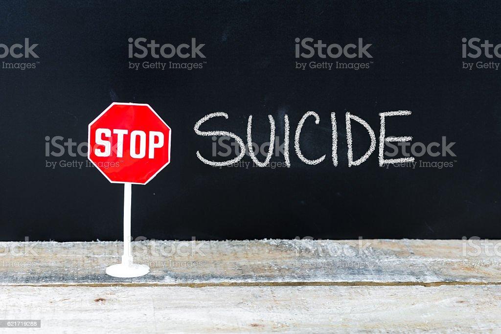 STOP SUICIDE message written on chalkboard stock photo