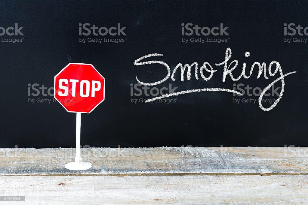 STOP SMOKING message written on chalkboard stock photo