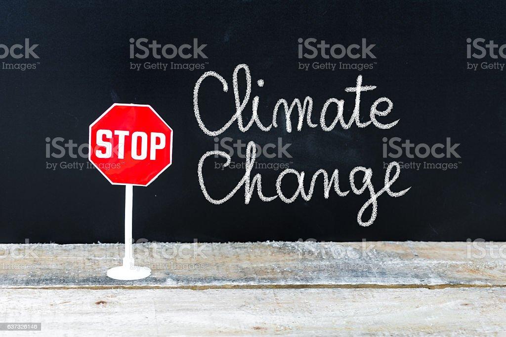 STOP CLIMATE CHANGE message written on chalkboard stock photo