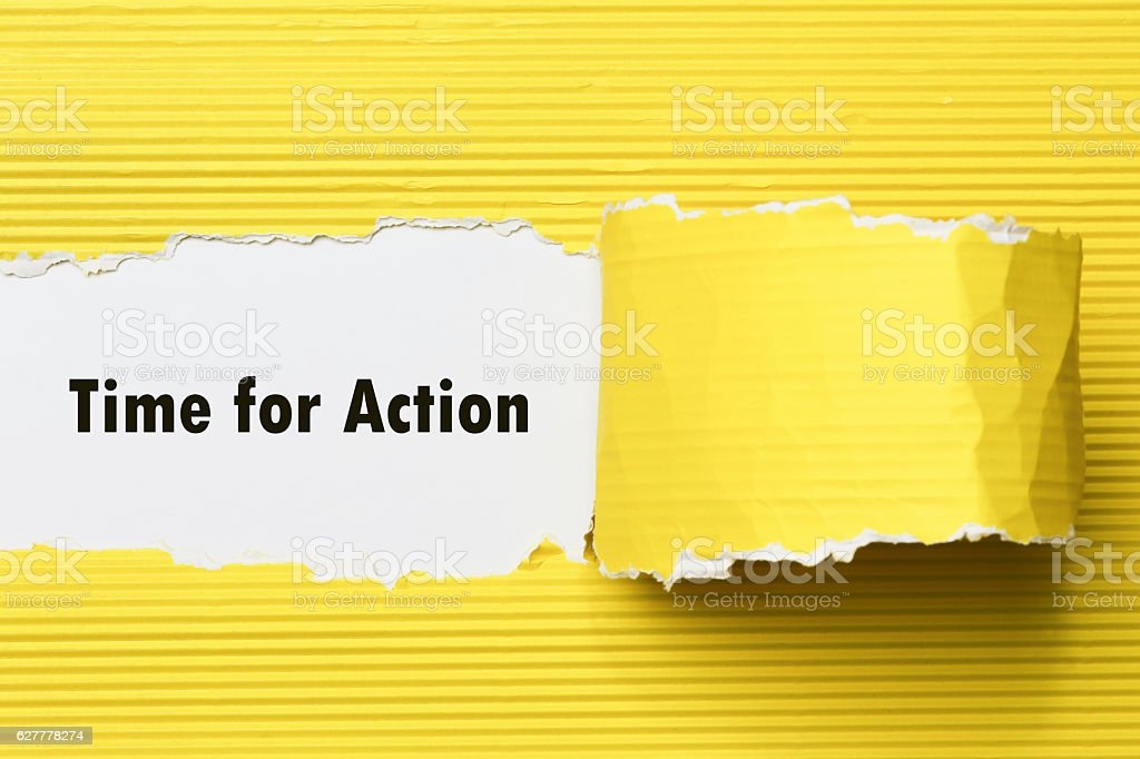 TIME FOR ACTION message written under torn paper. stock photo