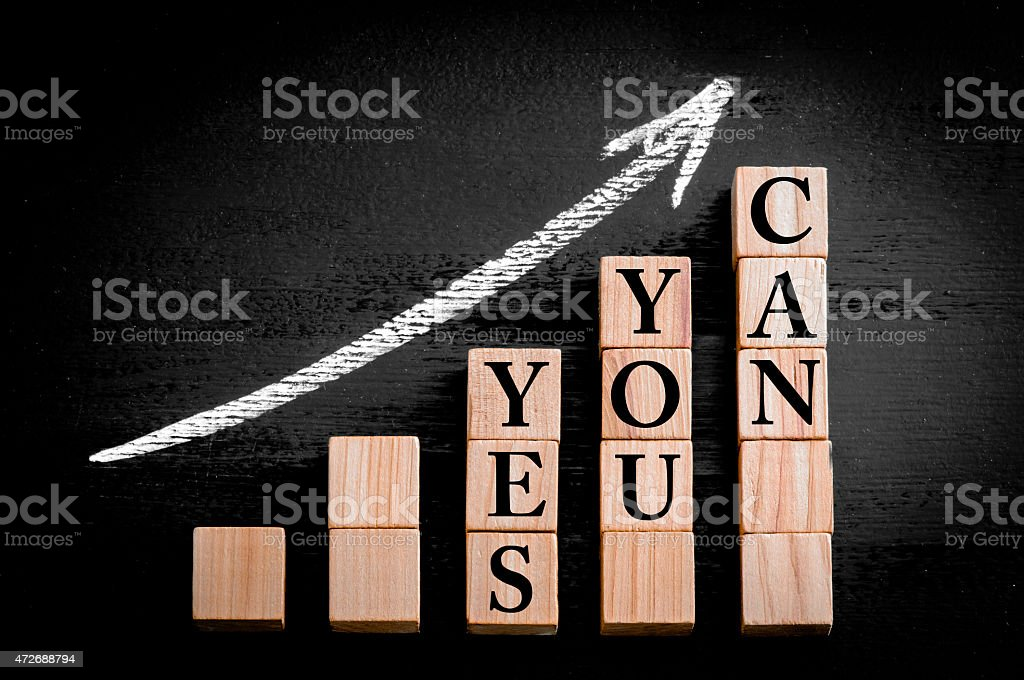 Message YES YOU CAN on ascending arrow above bar graph stock photo