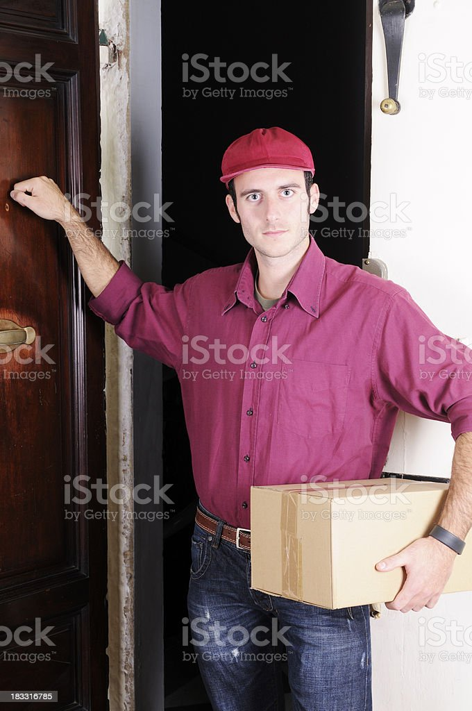 Messenger Delivering Gift Box and Knocking royalty-free stock photo