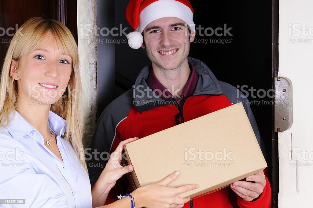 Messenger Delivering Gift Box for Christmas royalty-free stock photo