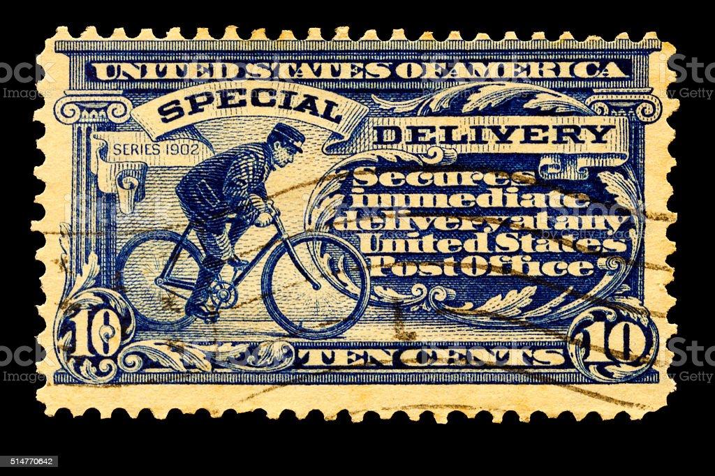 Messenger on Bicycle Postal Stamp stock photo
