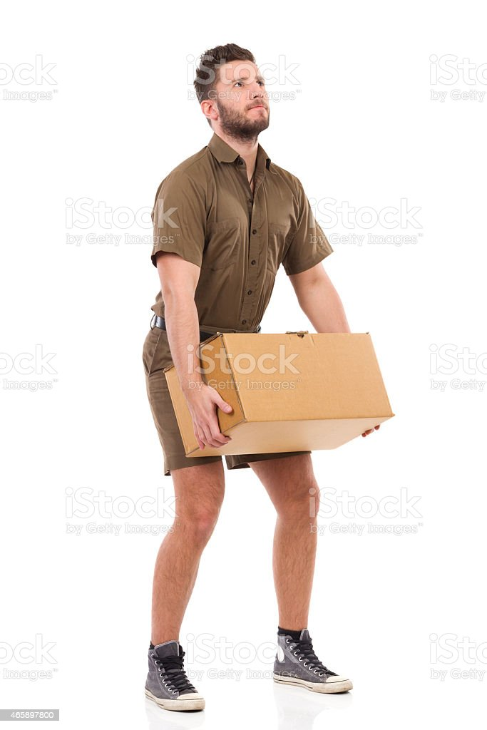 Messenger picking up a package. stock photo