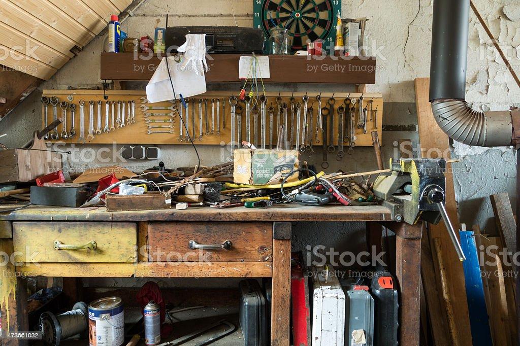 Messy abandoned workshop stock photo