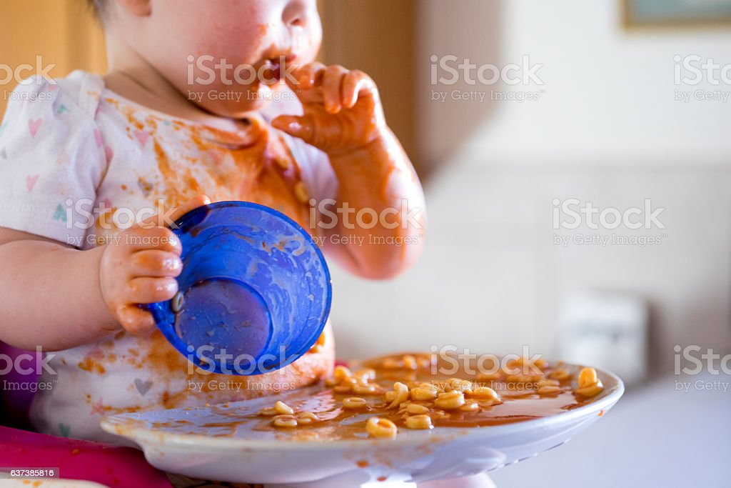 Messy Baby Eaiting stock photo