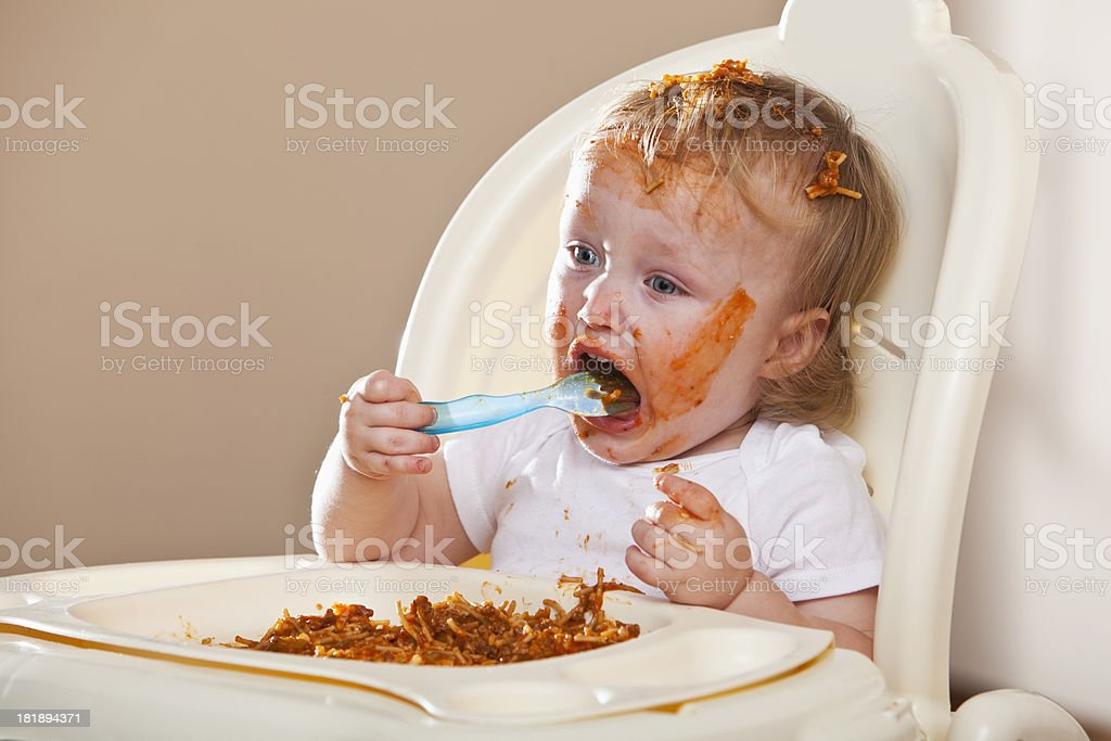 Messy baby eating royalty-free stock photo