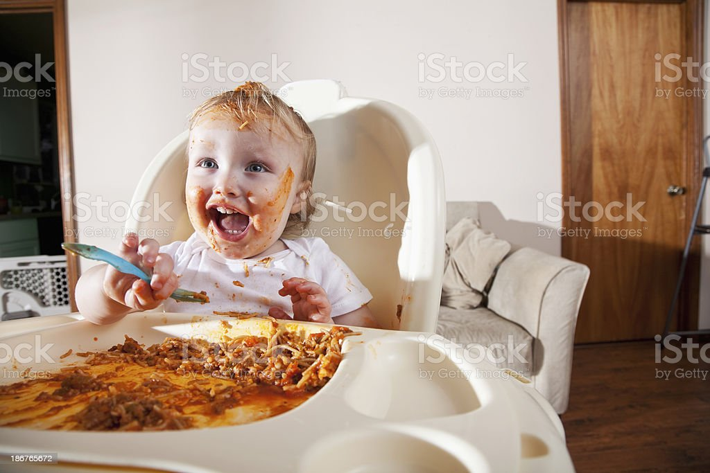 Messy baby eating stock photo