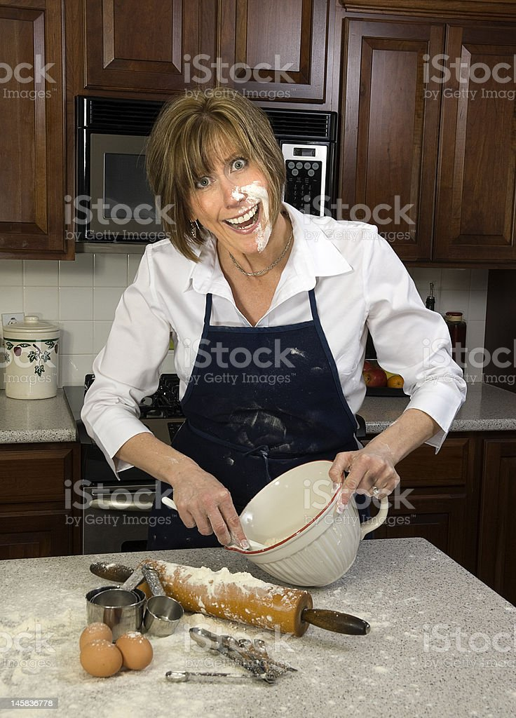 Messy Baker Woman in  the Kitchen royalty-free stock photo