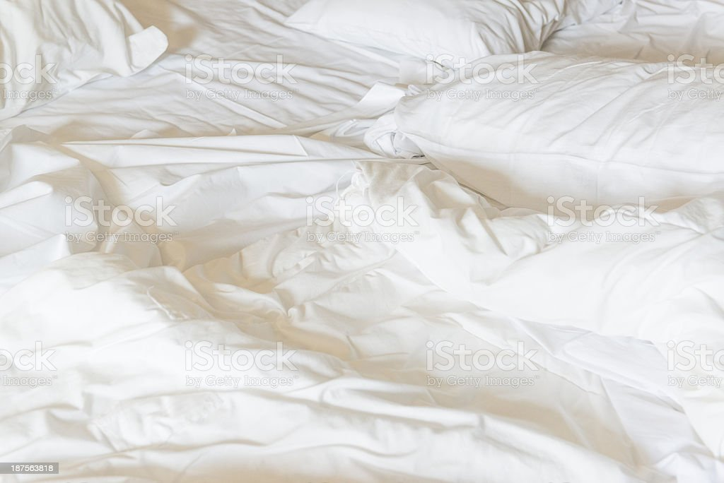 Messy Bed sheets and pillows royalty-free stock photo