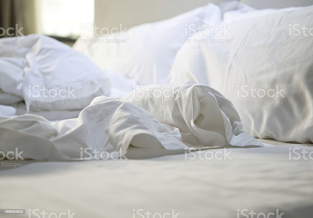 messy bedding sheets stock photo