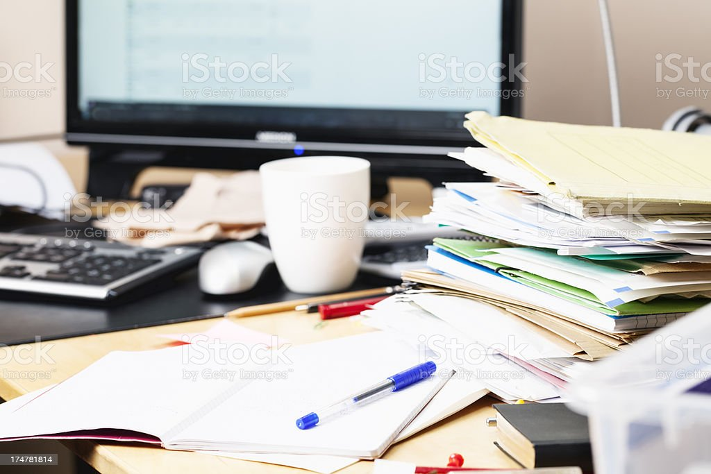 messy desk paperwork royalty-free stock photo