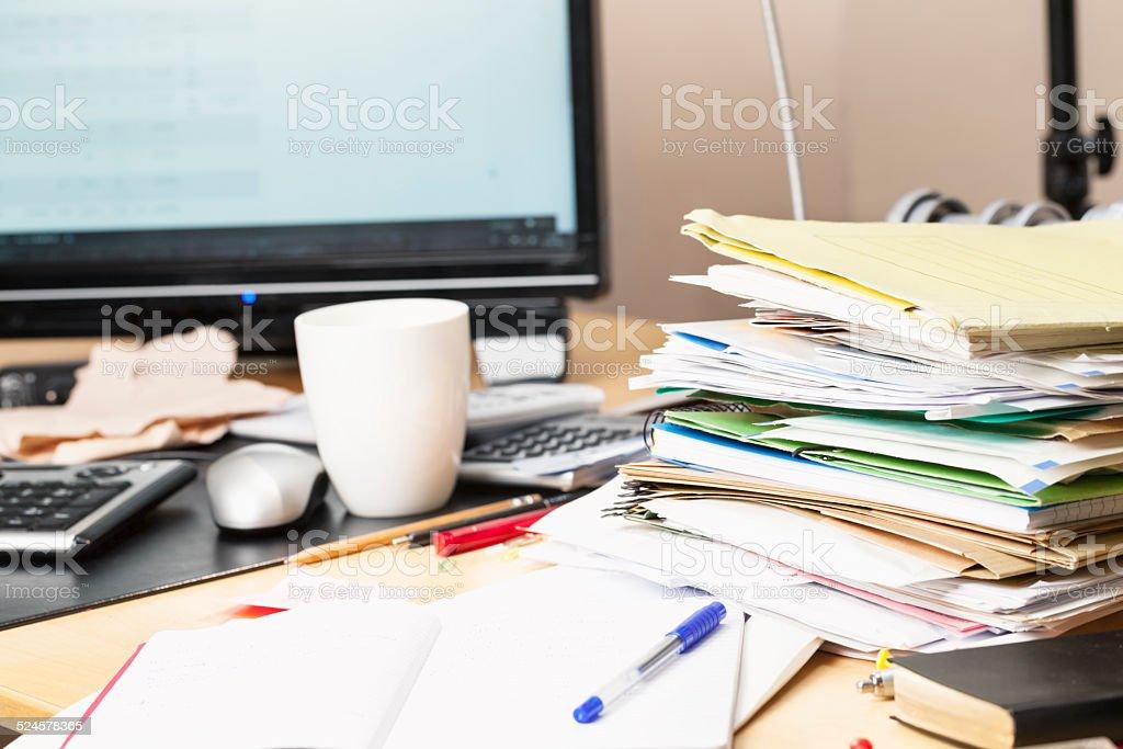 messy desk paperwork stock photo
