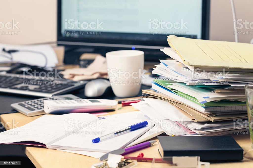 messy desk paperwork stock photo